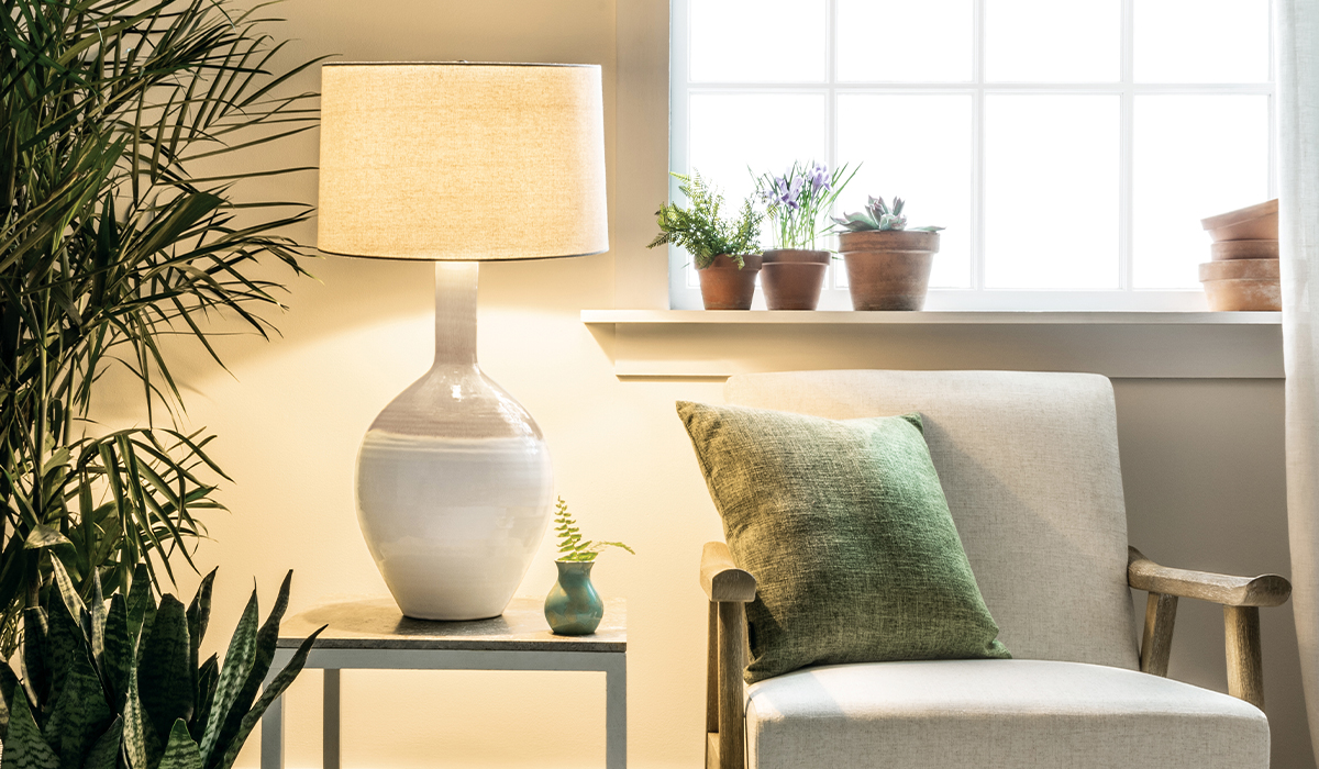 Warren Pottery Lamp With Curio Bud Vase in Jade Against Living Room Setting