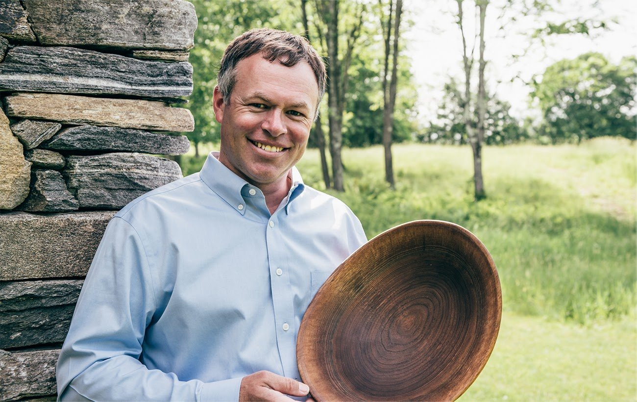 ANDREW PEARCE HOLDING WOODEN BOWL