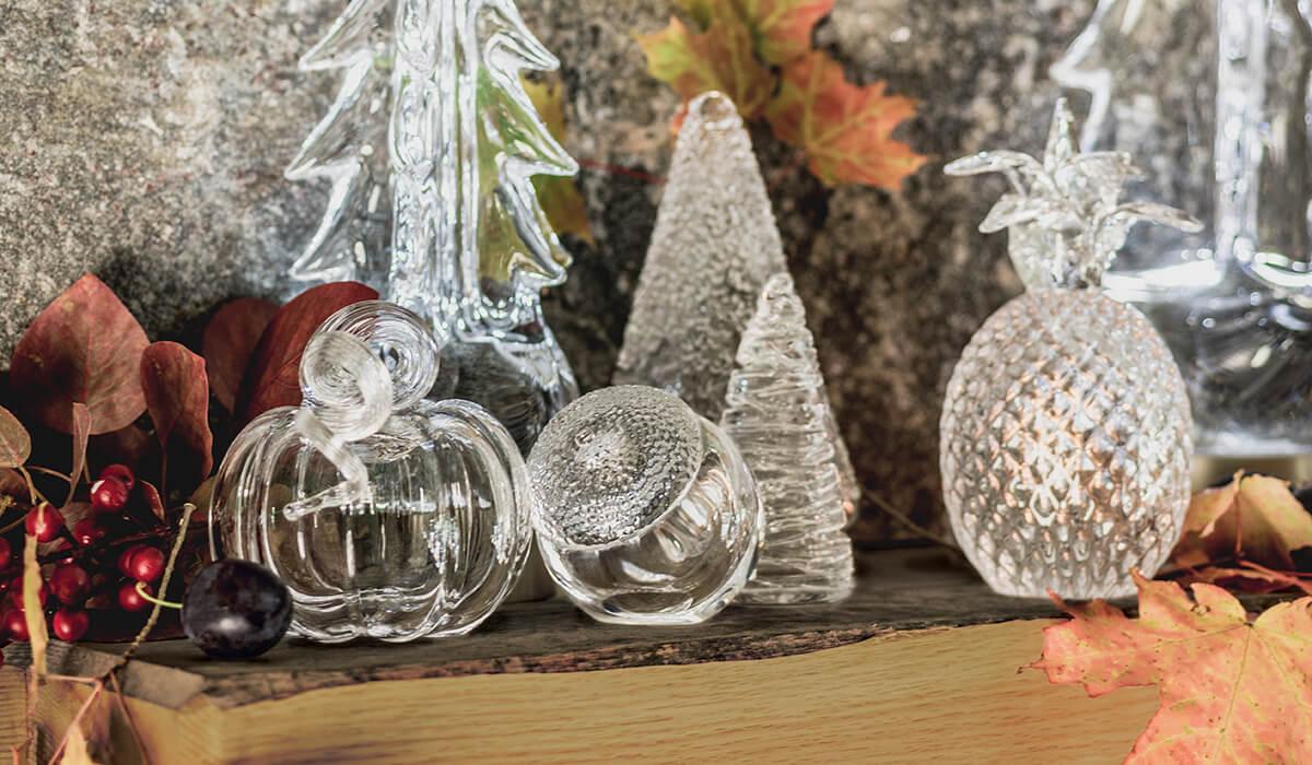 Mantel table with glass pumpkin, glass acorn, glass pineapple, echo lake tree, sterling tree