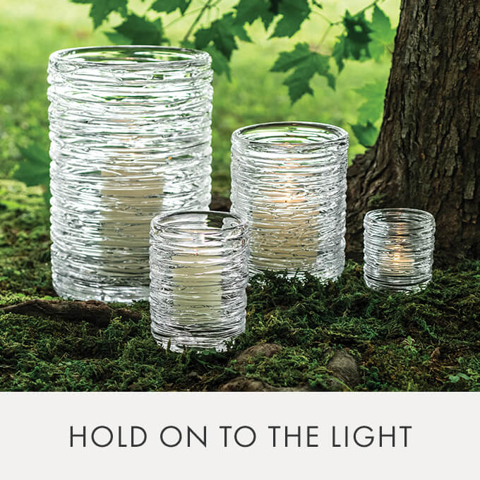 Echo Lake Hurricane - Less daylight = more candlelight. Make the transition ever-so soothing with flickering pillars in light-diffusing vessels. > SHOP HURRICANES