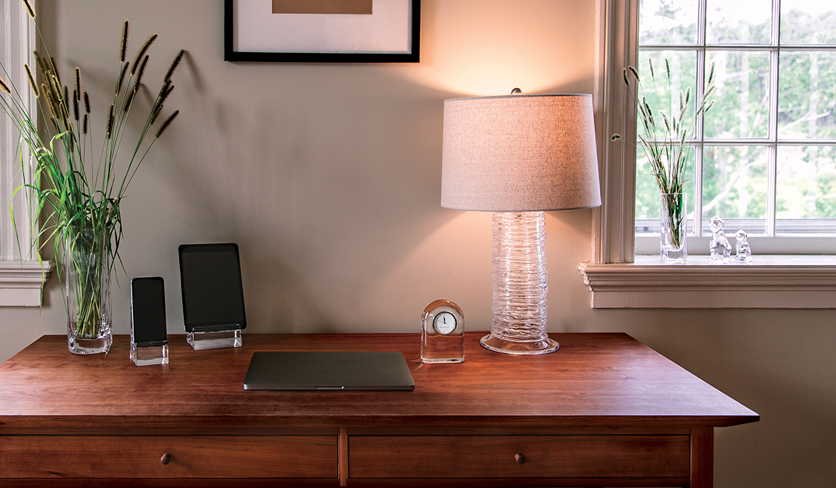 BARRE CLOCK, WOODBURY VASE, WOODBURY TABLET HOLDER, ECHO LAKE LAMP, WOODBURY PHONE HOLDER, PUPPY + DOG ON DESK WITH WINDOW IN BACKGROUND