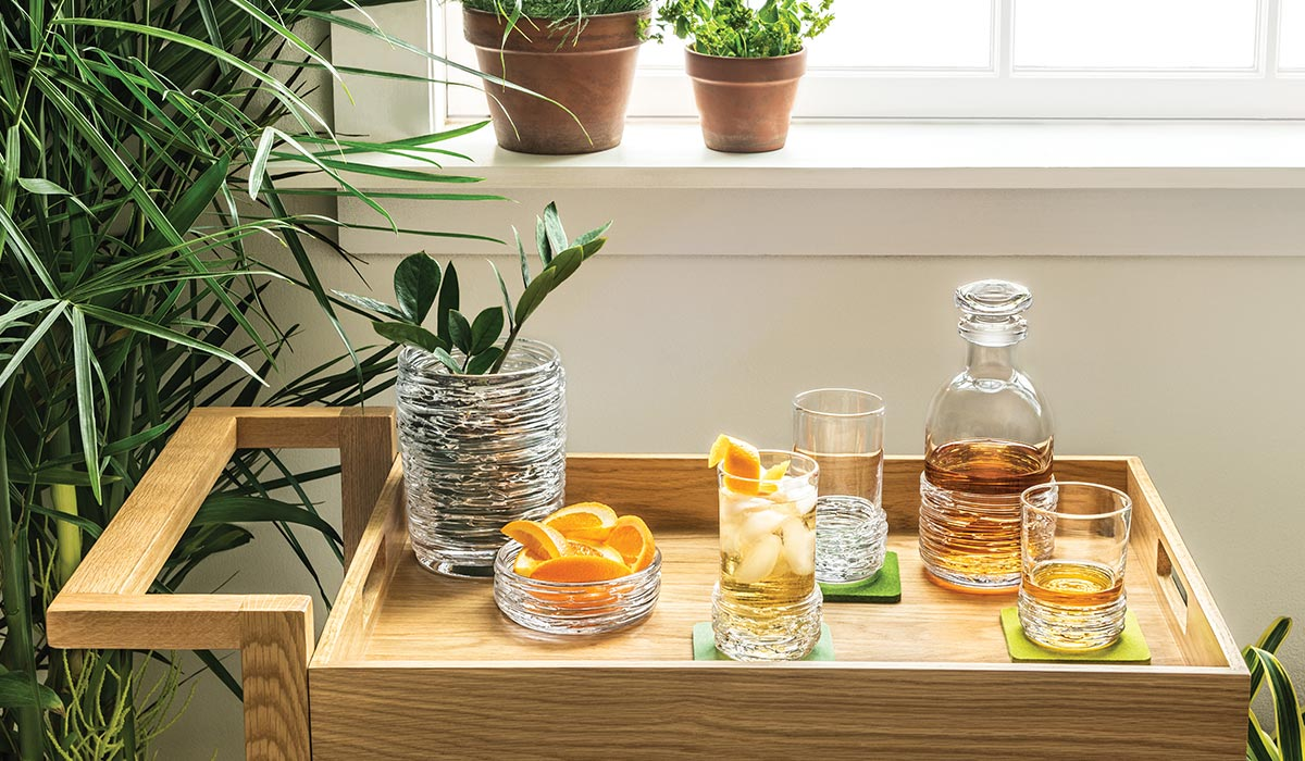 A Home Bar Setting Featuring Echo Lake Barware and Vases With Fruit